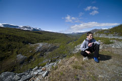 Boy in Finland countryside mountains Royalty Free Stock Images