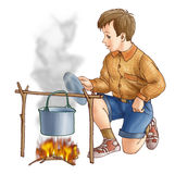 The boy at a fire. The boy on a fire cooks food Royalty Free Stock Images