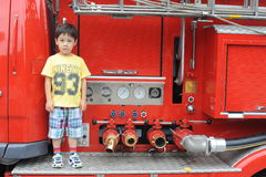 Boy on a fire engine Royalty Free Stock Photos