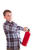 Boy with a fire extinguisher Stock Image