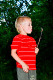 A boy and a fire. Boy kindles a fire in the garden stock images