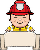 Boy Firefighter Banner. A cartoon illustration of a firefighter boy with a banner Stock Image