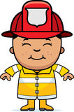 Boy Firefighter. A cartoon illustration of a firefighter boy standing and smiling Stock Image