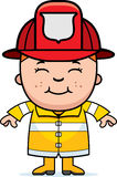 Boy Firefighter. A cartoon illustration of a firefighter boy standing and smiling Royalty Free Stock Photos
