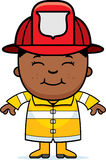 Boy Firefighter. A cartoon illustration of a firefighter boy standing and smiling Royalty Free Stock Photo