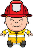 Boy Firefighter Sitting Stock Images