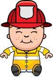 Boy Firefighter Sitting. A cartoon illustration of a firefighter boy sitting and smiling Stock Images
