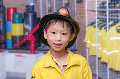 Boy in firefighter uniform Royalty Free Stock Photography