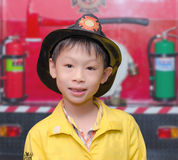 Boy in firefighter uniform Stock Photo