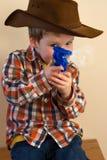Boy firing cap gun Royalty Free Stock Images
