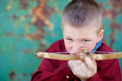 Boy Firing a Crossbow. Young boy aiming a crossbow, ready to shoot Stock Image