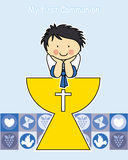 Boy First Communion. Card. children with calyx Stock Photo