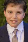 Boy first communion dress smiling to the camera Stock Photo
