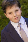 Boy first communion dress smiling to the camera Royalty Free Stock Photos