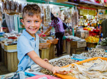 Boy at fish market Stock Photos