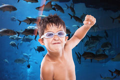 Boy and the fish Royalty Free Stock Photo