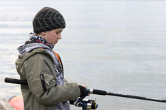 Boy fishing Stock Photos