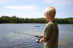 Boy Fishing. In a lake Stock Photography