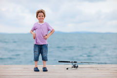 Boy fishing. Cute 5 years old boy fishing from the jetty stock photos