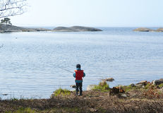 Boy fishing. Young boy with a lifevest fishing Royalty Free Stock Images