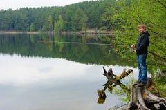 Boy fishing Stock Images