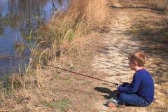 Boy Fishing. A young boy fishing on a lake Stock Photography