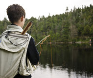 Boy Fishing. A boy fly fishing on a pristine mountain pond Stock Photography
