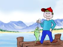 A boy fishing. A boy has just caught his first fish while fishing on the dock Royalty Free Stock Image