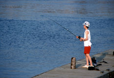 Boy Fishing. A boy fishing from a dock. Ottawa, Ontario Stock Images
