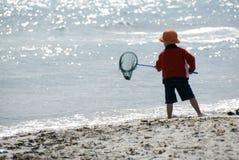 Boy fishing. On the beach Stock Photos