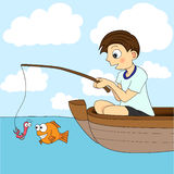 Boy Fishing In A Boat. A cute little boy fishing in a boat. The worm is about to become fish food Royalty Free Stock Image