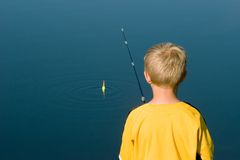 Boy Fishing with Bobber. Action Royalty Free Stock Photography
