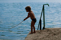 Boy fishing Stock Image