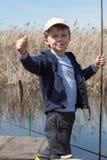 Boy while fishing Royalty Free Stock Photos