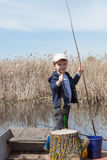 Boy while fishing Royalty Free Stock Photo