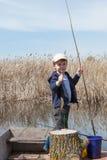 Boy while fishing Royalty Free Stock Photo