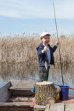 Boy while fishing Royalty Free Stock Image