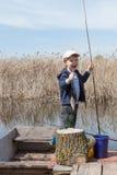 Boy while fishing Royalty Free Stock Image