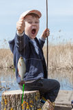 Boy while fishing Royalty Free Stock Images