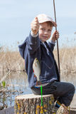 Boy while fishing Stock Image