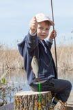Boy while fishing Stock Image