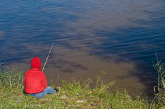 Boy fishing on lake Royalty Free Stock Photography