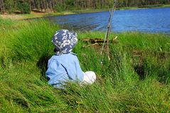 Boy fishing on lake Stock Photography