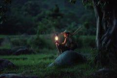 Boy fishing with lantern Royalty Free Stock Photo