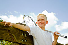 Boy with fishing net Royalty Free Stock Photos