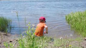 Boy fishing net on the river Bank. Beautiful summer landscape. Outdoor recreation. Summer holidays in the village. Boy fishing net on the river Bank. Outdoor stock footage