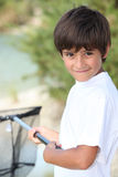 Boy with a fishing net Royalty Free Stock Photography