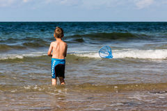 Boy with fishing net Stock Photos