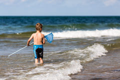 Boy with fishing net Royalty Free Stock Photo