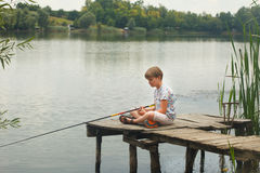 Boy fishing on the pond Stock Photography